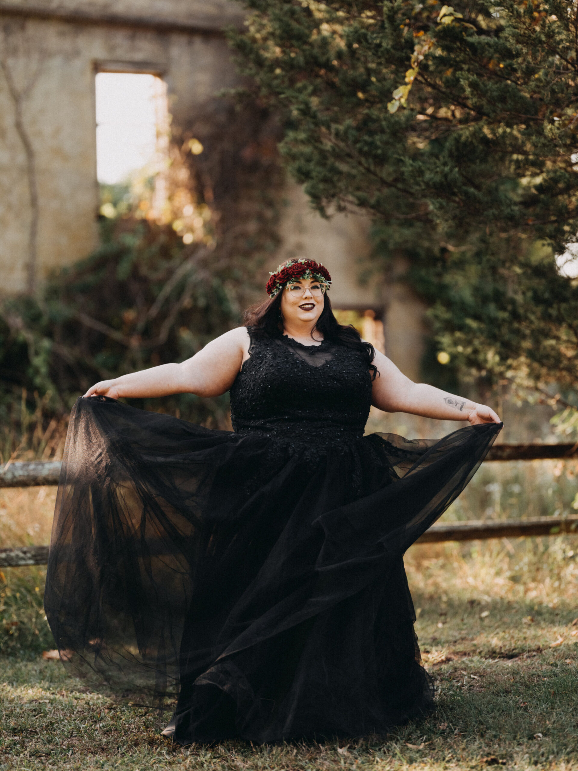 Woman wearing a black dress for her Halloween Engagement Session