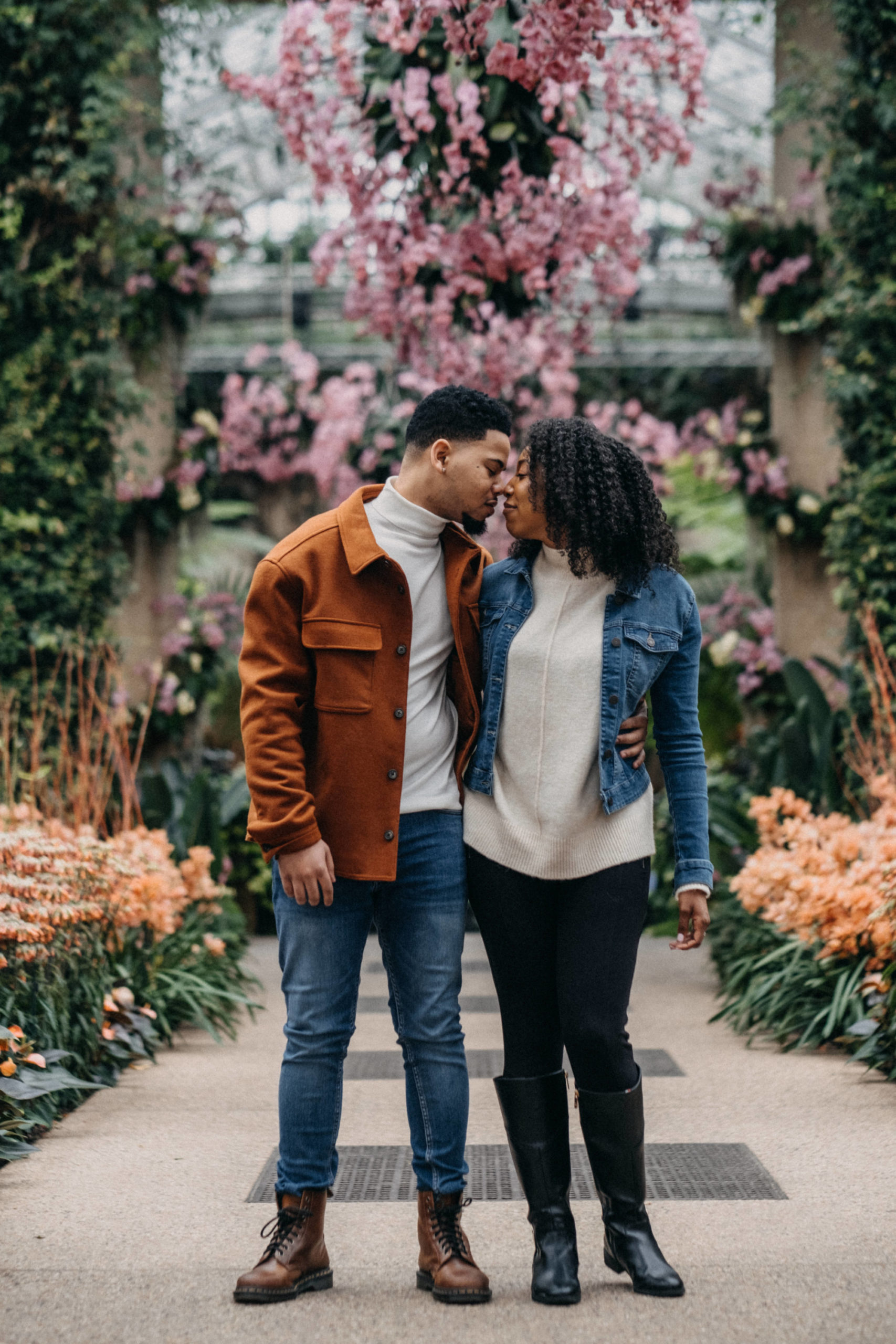 Man and Woman arms around their waist with foreheads together during their Longwood Gardens Engagement session.